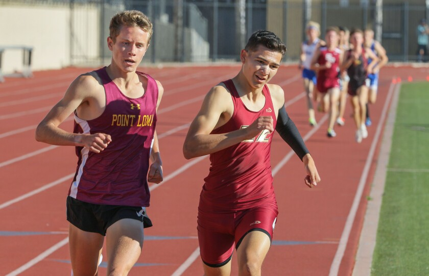 Jonathan Velasco of Mission Hills (right) and Hunter Sweet of Point Loma duel for the lead in the 1,600 meters on Friday at the Escondido Invitational. Velasco won the race.
