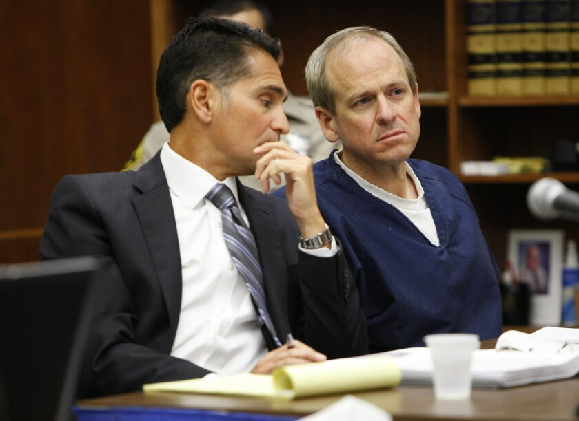 Former biotech executive Hans Petersen, right, and his defense attorney, Marc Carlos, look on as the defendants' victims testified in San Diego Superior Court. Peterson was found guilty of shooting his former business partner, Steven Dowdy, and former brother-in-law, Ron Fletcher.