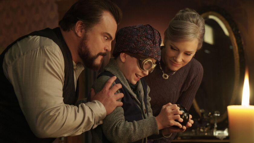 """From left, Jack Black, Owen Vaccaro and Cate Blanchett star in Universal's """"The House with a Clock in Its Walls,"""" from Amblin Entertainment."""