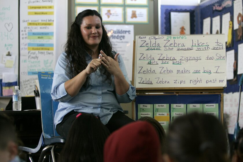 Teacher Linda Herschmiller, who got a layoff notice this month, led her kindergartners through Friday's reading lesson at Johnson Elementary in El Cajon.