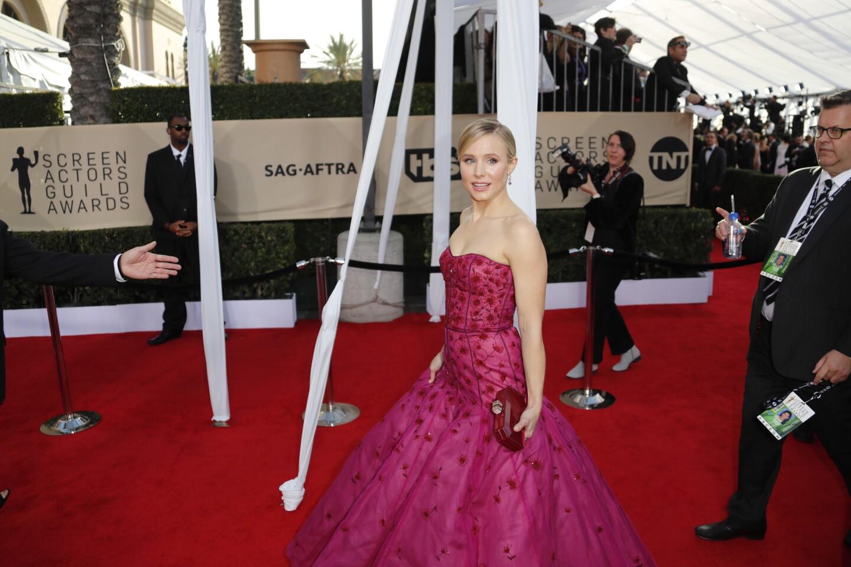Actress Kristen Bell, the SAG Awards' first host, walks the red carpet.