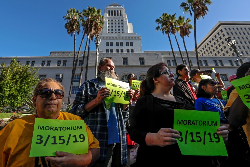Tenants and their advocates rally outside Los Angeles City Hall