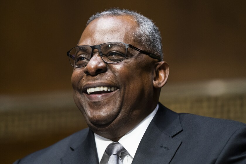 Lloyd J. Austin III smiles during his confirmation hearing before the Senate Armed Services Committee on Tuesday.
