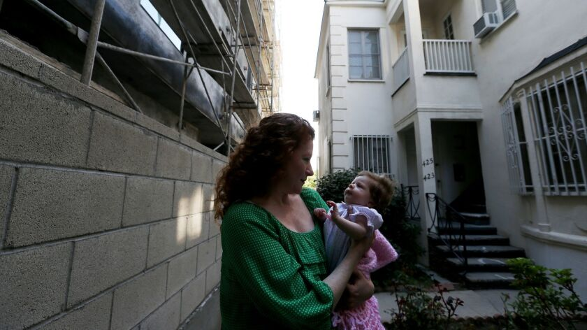A woman and her daughter live in an apartment building that was purchased by a company that's evicted more than 300 tenants over the past decade in Los Angeles, Calif. on Feb. 23, 2016.