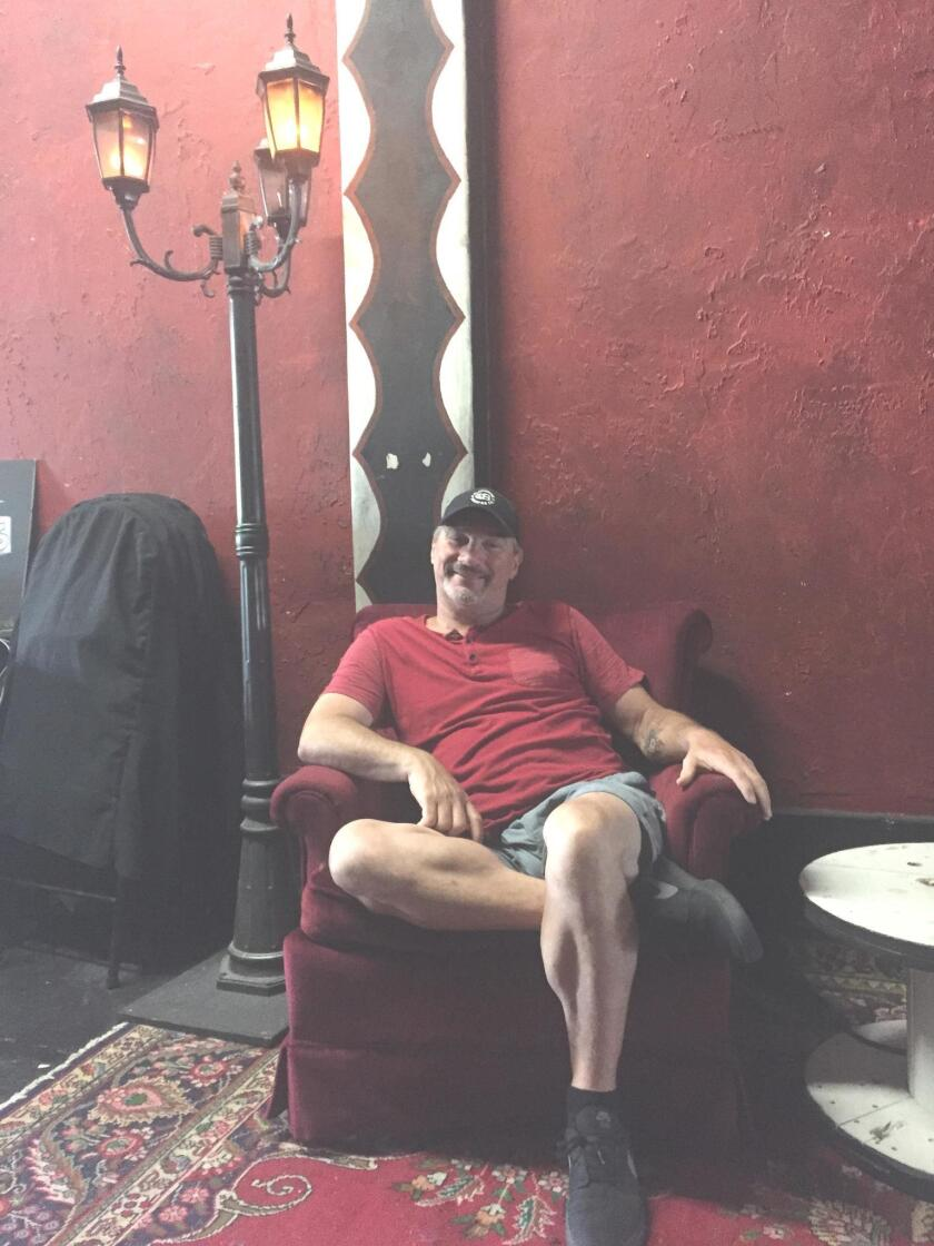 Producer Bill Connard relaxes in the OB Playhouse lobby.