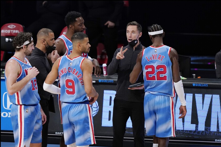 Brooklyn Nets head coach Steve Nash talks to Nets' Joe Harris (12), Jeff Green, Timothe Luwawu-Cabarrot (9) and Caris LeVert (22) during the second half of an NBA basketball game against the Oklahoma City Thunder, Sunday, Jan. 10, 2021, in New York. The Thunder defeated the Nets 129-116. (AP Photo/Kathy Willens)