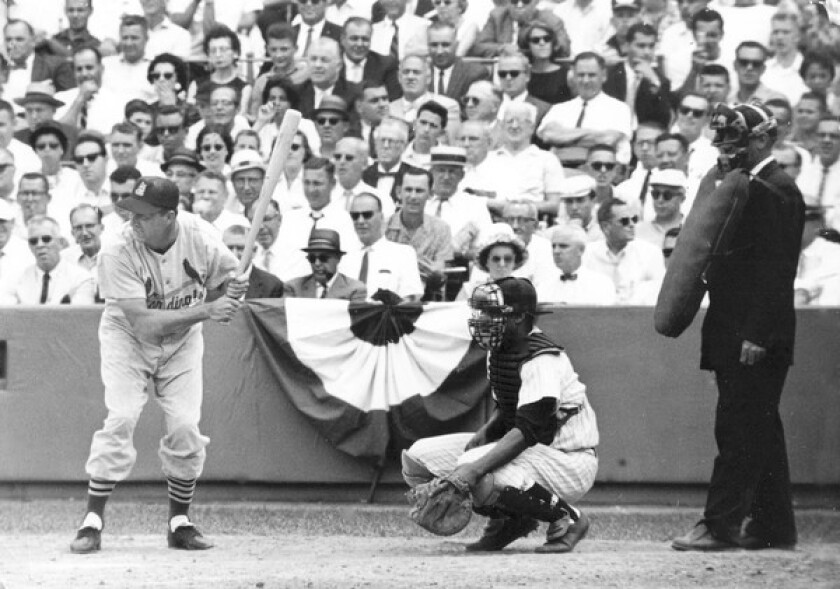 Stan Musial bats in the 1949 All-Star Game at Ebbets Field, Brooklyn. His pal fron St. Louis, Yogi Berra, is the catcher.
