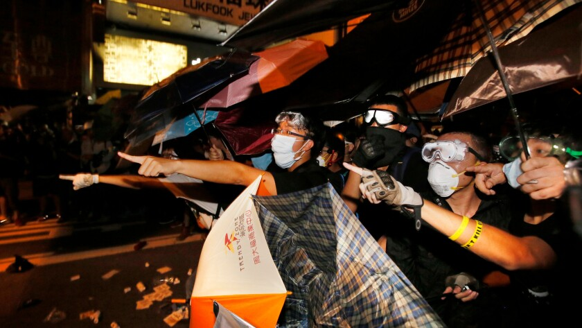 Pro-democracy protesters shout at police in the Mong Kok district of Hong Kong