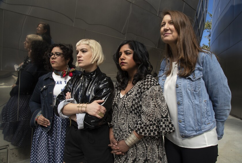 From left: Singer Marisoul Hernandez; Girlschool founder Anna Bulbrook; musical director Shruti Kumar; and L.A. Philharmonic director of presentations Johanna Rees are four of more than 75 women-identified participants in an upcoming tribute to Yoko Ono at Disney Hall.