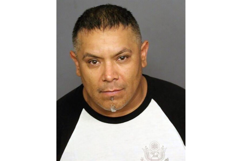 This booking photo provided by the Denver Police Department shows Ricardo Rodriguez. Rodriguez was one of four people arrested after more than a dozen weapons and hundreds of rounds of ammunition were seized at a downtown Denver hotel that is close to several events planned in conjunction with the upcoming Major League Baseball All-Star Game. Investigators have not found any evidence to suggest the group was plotting a mass shooting or other similar attack, the official said, while cautioning that the investigation is still in its early stages.(Denver Police Department via AP)