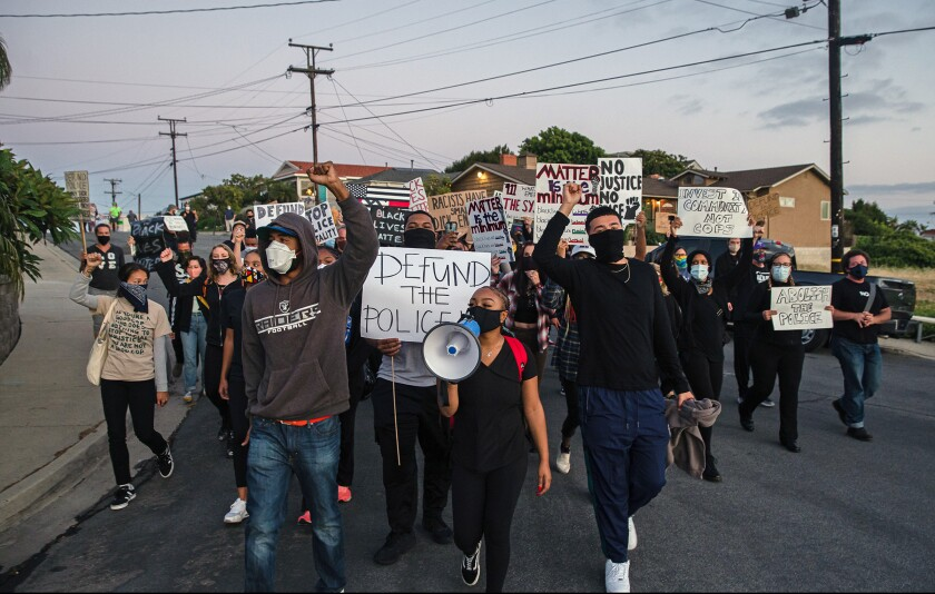 Protesters march through San Diego Mayor Kevin Faulconer's neighborhood on June 29, 2020.