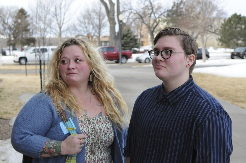 Jessie Lamphere, a transgender high school student, stands with his mom, Tyler Lamphere, left, after a brief hearing at the state Capitol in Pierre, S.D., Tuesday, Jan. 31, 2017. A bill that would have restricted which locker rooms South Dakota transgender students could use was withdrawn Tuesday.