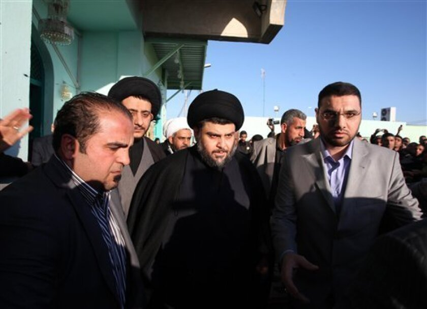 Anti-American cleric Muqtada al-Sadr, center, is surrounded by bodyguards in the Shiite city of Najaf, Iraq, Thursday, Jan. 6, 2011. Hundreds of raucous supporters celebrated the return of the firebrand Iraqi cleric Thursday after his emergence from four years of exile in Iran, drawing a plea from him to show more discipline and restraint.(AP Photo/Alaa al-Marjani)