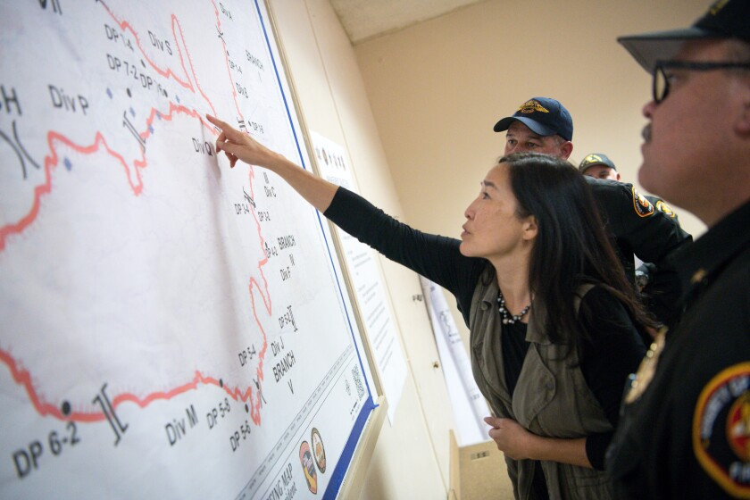 Sachi Hamai, Los Angeles County chief executive officer, reviews an operations map with fire commanders battling the devastating Woolsey fire in 2018.