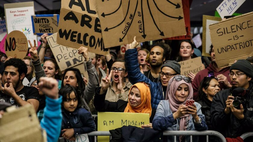 Protesters greet international arrivals at San Francisco International Airport as they gather to denounce Trump's immigration order on Jan 29.