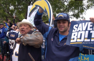 Fans rally outside Chargers Park as team heads to Cleveland