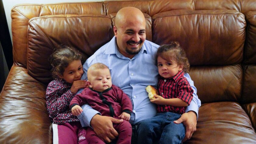 Masoud Zarify and his children, Setayesh Zarify (age 6), Mesbah Zarify and Merag (3 months) Zarify at their apartment in Rancho Penasquitos. Zarify worked as a contractor for the Americans in Afghanistan and arrived in the U.S. with a special visa in 2016.