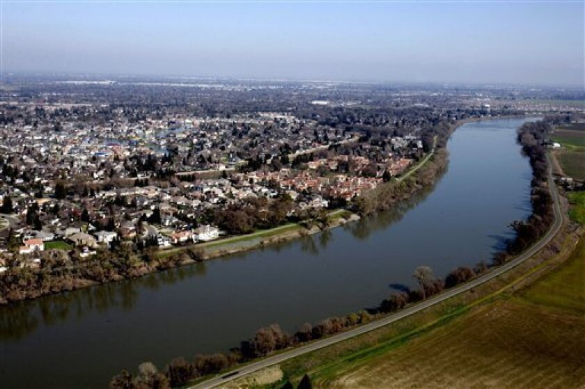 In this 2006 file photo, houses located in the Pocket Area of Sacramento, Calif., are seen along the Sacramento River. On July 25, 2012, the state announced plans to build two tunnels that would carry part of the Sacramento River's flow underneath the Delta and to the California Aqueduct.