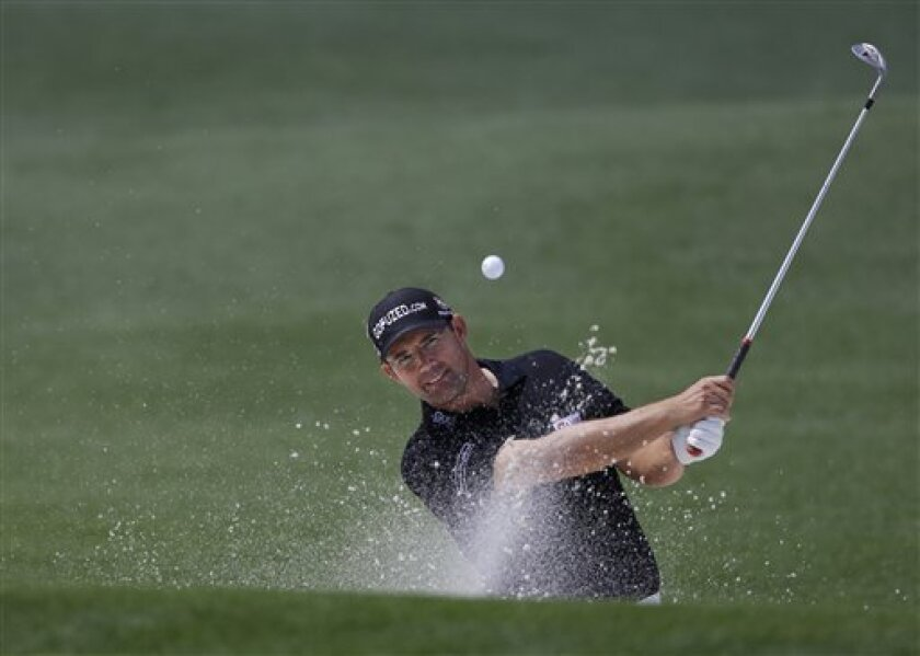 Padraig Harrington, of Ireland, watches his chip shot out of a bunker on the third hole during a practice round for the Masters golf tournament Tuesday, April 9, 2013, in Augusta, Ga. (AP Photo/Darron Cummings)