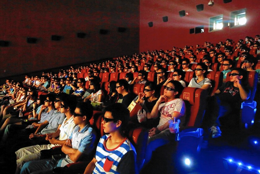 "Hollywood executives have learned to greet news of a partnership with Chinese firms with a degree of skepticism. Above, audiences in China watch a 3-D showing of ""Transformers: Age of Extinction."""