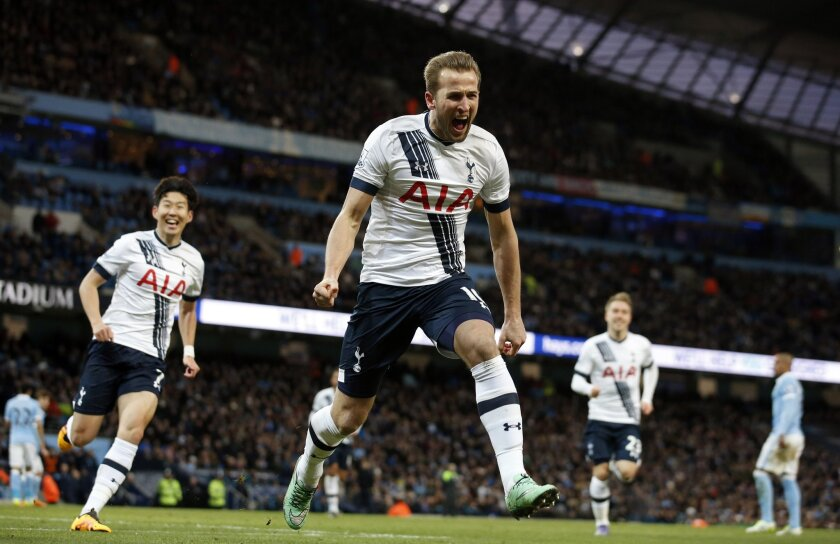 Tottenham's Harry Kane celebrates after scoring the opening goal during the English Premier League soccer match between Manchester City and Tottenham Hotspur's at the Etihad Stadium in Manchester, England, Sunday Feb. 14, 2016. (AP Photo/Jon Super)