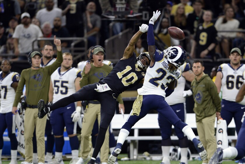 Los Angeles Rams defensive back Nickell Robey-Coleman (23) breaks up a pass intended for New Orleans Saints wide receiver Tre'Quan Smith (10) in the second half of an NFL football game in New Orleans, Sunday, Nov. 4, 2018.