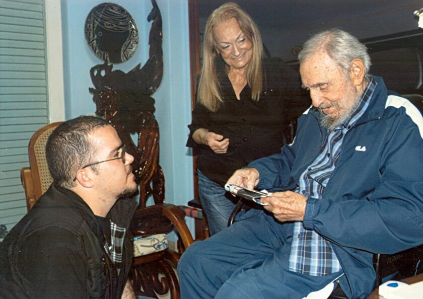 A picture dated Jan. 23 and released by Cuban website Cubadebate on Feb. 3 shows former Cuban President Fidel Castro with his wife, Dalia Soto del Valle, meeting with student leader Randy Perdomo Garcia in Havana.