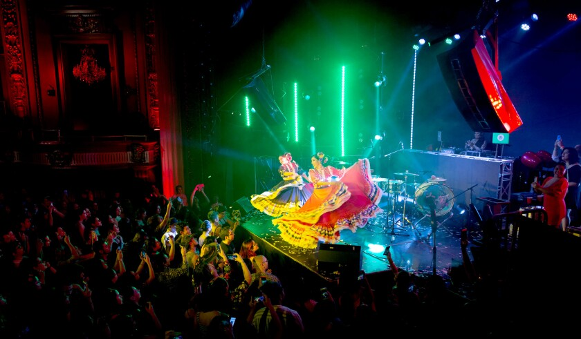 Dancers perform in front of an audience at a Cumbiaton event.