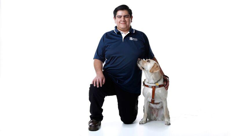 Daniel Ortiz Merino, with his guide dog, Amber.