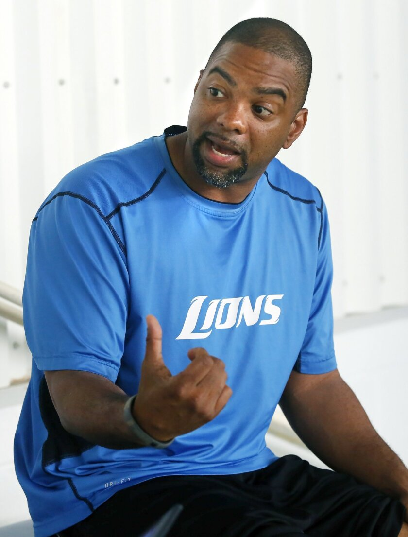 Detroit Lions Senior Director of Player Development Galen Duncan gestures while talking with a reporter during the final day of NFl football minicamp Thursday, June 12, 2014, in Detroit. (AP Photo/Duane Burleson)