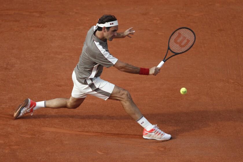 Roger Federer durante un partido contra Stan Wawrinka