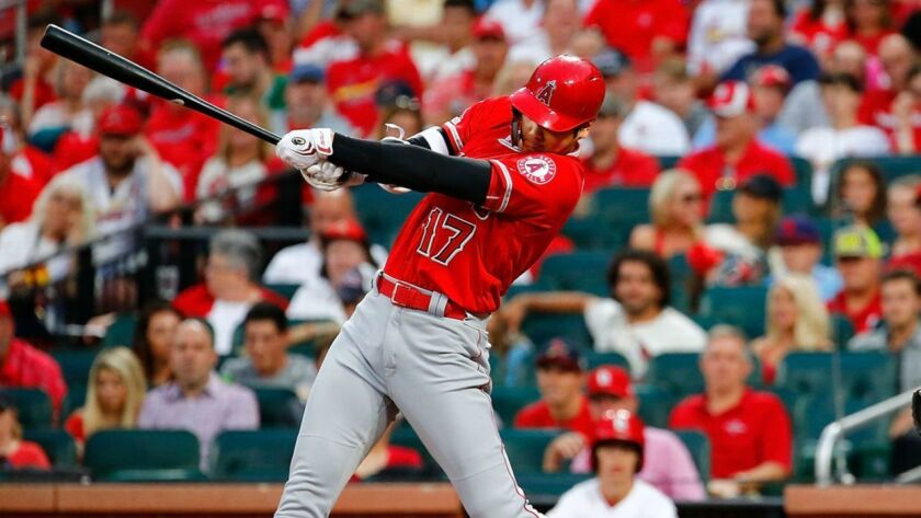Angels designated hitter Shohei Ohtani swings at a pitch during a victory Sunday over the St. Louis Cardinals. Ohtani says he's be honored to compete in the Major League Baseball home run derby.