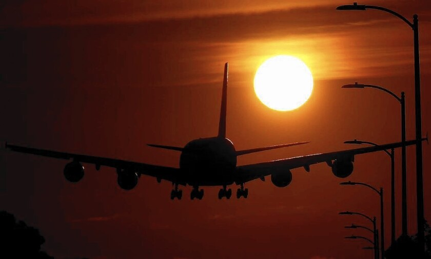 A plane lands at LAX. Culver City residents are complaining about an apparent increase in low-flying, noisy aircraft over their neighborhood.