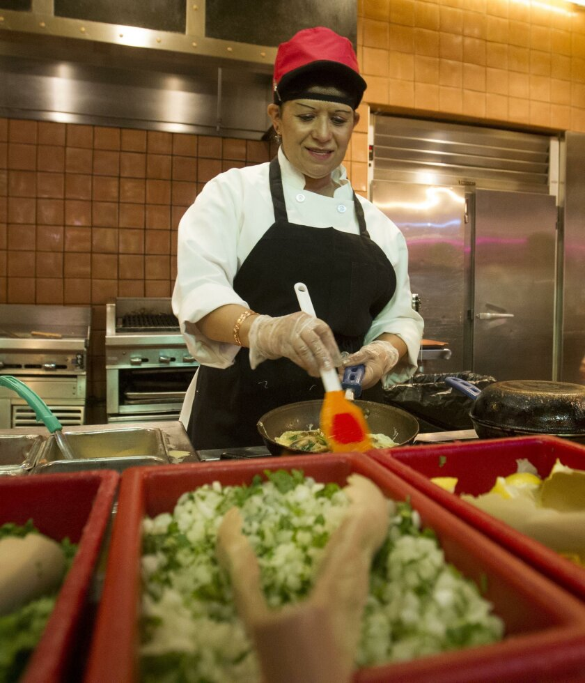 SAN DIEGO, CA-OCTOBER 12, 2015: Barona Casino was named the best place to work in U-T Readers Poll.  Irma Hernandez Zavala made omeletes in the buffet line.  (JOHN GIBBINS / San Diego Union-Tribune)  User Upload Caption: Irma Hernandez Zavala made omelets in the buffet line at Barona Resort & Casin