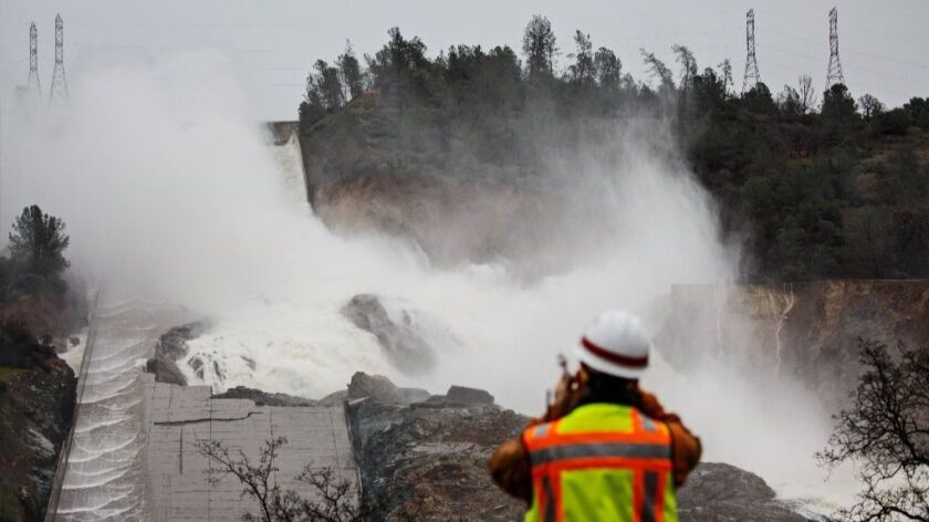 Work crews were scrambling Sunday to shore up the damaged spillways at the Oroville Dam as another big storm moves into the area.