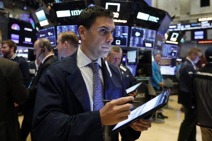 FILE - In this Feb. 6, 2020, file photo trader Craig Spector works on the floor of the New York Stock Exchange. The U.S. stock market opens at 9:30 a.m. EST on Wednesday, Feb. 12. (AP Photo/Richard Drew, File)