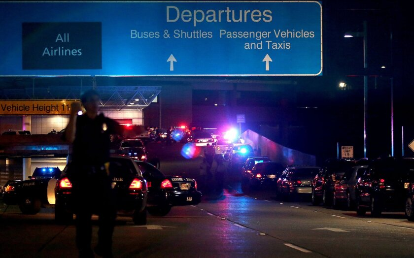 The ramp to departures is seen blocked off by emergency vehicles  at the New Orleans International Airport, Friday, March 20, 2015, in Kenner, La. Richard White sprayed a TSA agent in the face with wasp killer then slashed a second guard with a machete before a third agent shot him three times at a