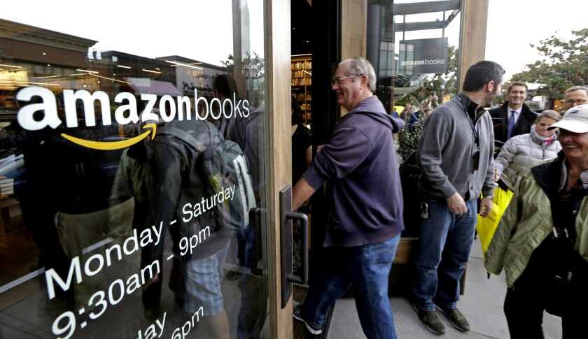 Customers enter at the opening day for Amazon Books, the first brick-and-mortar retail store for onl
