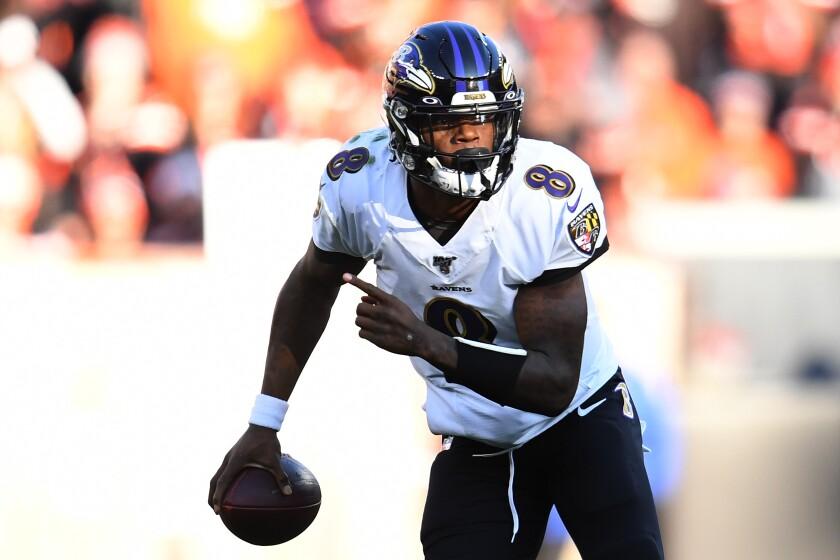 Ravens quarterback Lamar Jackson runs with the ball.