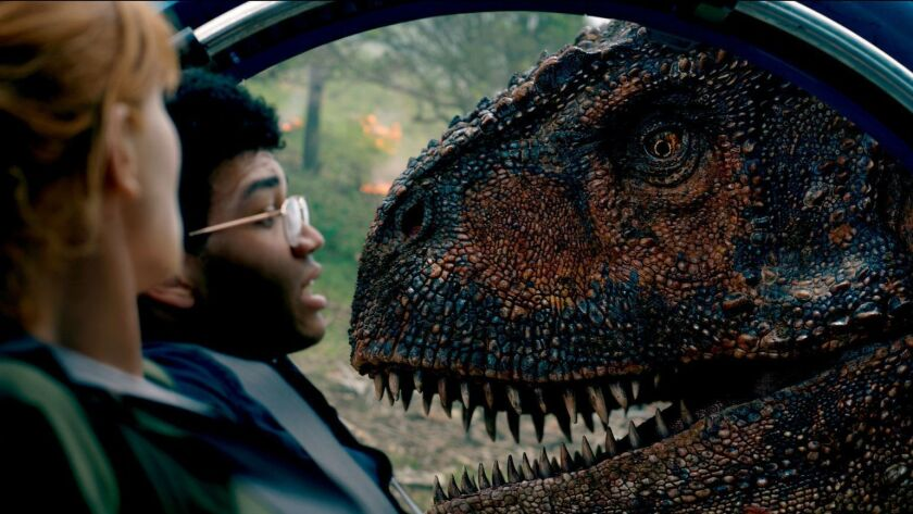 (L-R) - Claire (BRYCE DALLAS HOWARD) and Franklin (JUSTICE SMITH) are trapped by the Carnotaurus in