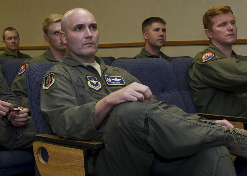In this Oct. 13, 2016, photo provided by the U.S. Air Force, Air Force Col. Todd Hohn, foreground, and pilots assigned to the 97th Air Mobility Wing are briefed on an exercise at Altus Air Force Base, Okla. Hohn, now a pilot for FedEx, was detained in Guangzhou, China, on Sept. 12, 2019, before boarding a commercial flight. The company said Thursday, Sept. 19, that he was later released, and it's working with Chinese authorities to understand what happened. (Airman 1st Class Kirby Turbak/U.S. Air Force via AP)