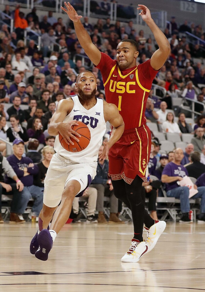 TCU guard Edric Dennis Jr. (2) drives the ball under the defense of Southern California guard Kyle Sturdivant (1) during the first half of an NCAA college basketball game in Fort Worth, Texas, Friday, Dec. 6, 2019. (Bob Booth/Star-Telegram via AP)