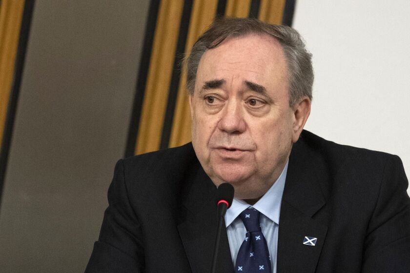 Former Scottish leader Alex Salmond makes his opening statement to a committee of the Scottish parliament at Holyrood in Edinburgh, Friday Feb. 26, 2021. Former Scottish leader Alex Salmond will lay out his belief that his successor tried to damage his reputation through an unfair probe of sexual harassment allegations when he appears before lawmakers Friday in a case that is tearing apart the country's biggest political party. (Andy Buchanan/Pool via AP