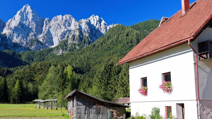 The Julian Alps together with the flower-filled houses creates scenes of unforgettable beauty