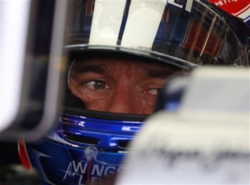 Australia's Red Bull Formula 1 driver Mark Webber sits in his car in the pits before the third practice session at the Silverstone circuit, Silverstone, England, Saturday, July 9, 2011. Webber, finished first in the qualifying session for Sunday's Grand Prix. to get the pole position, Germany's Red Bull Formula 1 driver Sebastian Vettel, finished second and Spain's Ferrari Formula 1 driver Fernando Alonso, finished third. The Formula One British Grand Prix at the 6-kilometer (3.7-mile) Silverstone circuit will take place on Sunday. (AP Photo/Lefteris Pitarakis)