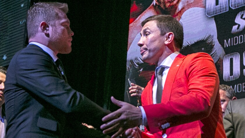 Boxers Canelo Alvarez, left, and Gennady Golovkin shake hands at the conclusion of a promotional eve