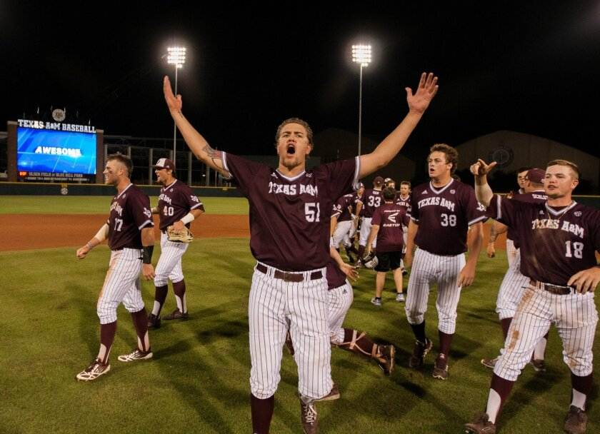 CORRECTS TO SUNDAY - Texas A&M pitcher Tyler Stubblefield (51) celebrates with teammates after Texas A&M defeated California 4-3 in 12 innings during an NCAA college baseball tournament regional game in College Station, Texas, Sunday, May 31, 2015. (AP Photo/Juan DeLeon}