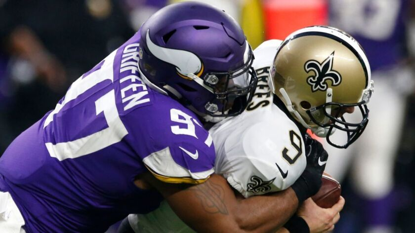 New Orleans Saints quarterback Drew Brees (9) is sacked by Minnesota Vikings defensive end Everson Griffen (97) during the first half on Sept. 11, 2017.