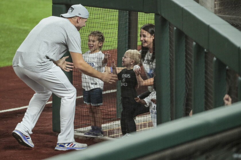Blake Treinen greets family members after the Dodgers beat the Braves in Game 7.