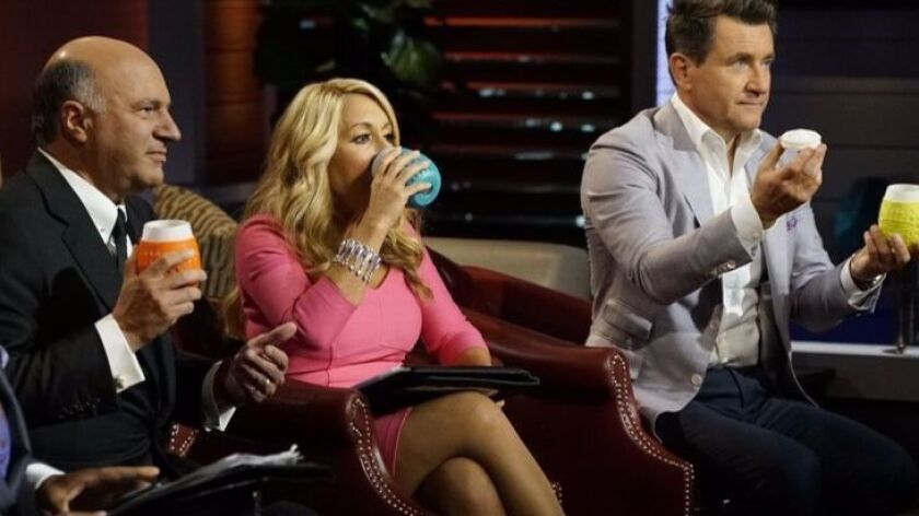 """Shark Tank's"" Kevin O'Leary (left) missed out on the wineglass deal, while Lori Grenier and Robert"